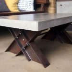Concrete coffee table with I-beam trestle legs