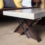 """Polished concrete coffee table with I-beam trestle legs"""