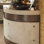 Curved polished concrete and steel reception counter at The Lodge Space