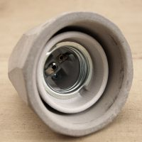 """Concrete bare bulb light fitting internal view"""