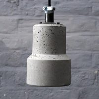 """Lander Brutalist Concrete Light with braided Flex and conduit cable clamp"""