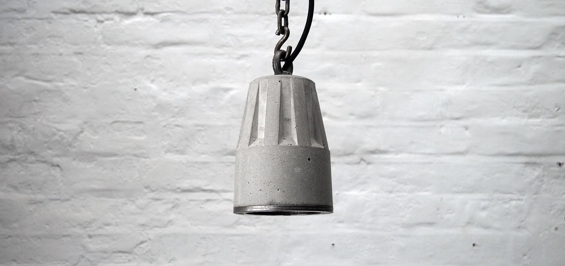 """Concrete pendant lamp with heavy duty hanging chain and steel edging ring"" ""By Brutal Design"""