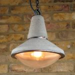 """UF-Zer0 Concrete and Steel Pendant Light with glass dome lens and filament bulb"