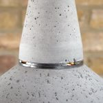 """Concrete and Steel Pendant Light with glass dome lens top section detail"" ""Steel ring connection detail"" ""by Brutal Design"""